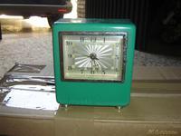 Reloj color verde,metal