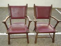 2 sillones de roble y polipiel rojo