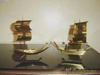 Pareja de velero metal con medha de aceite